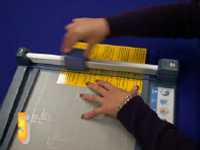 Photo of sheets being lined up on paper trimmer